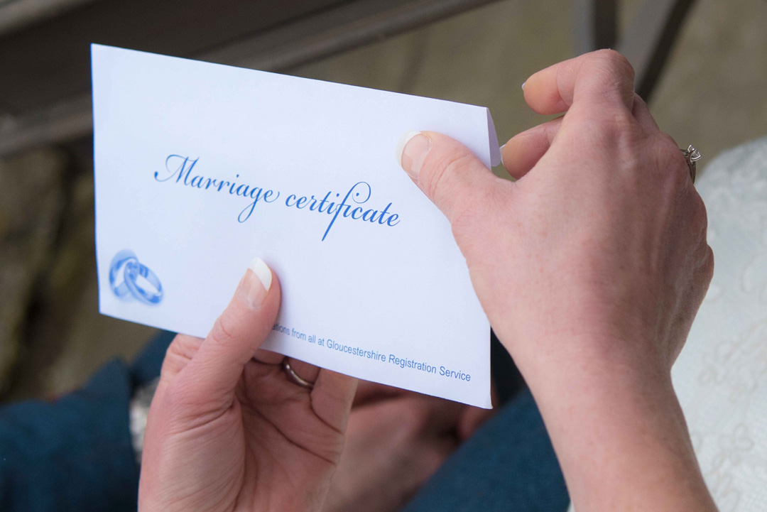 marriage certificate is tranditionally property of the bride, unstaged wedding photogrpahy by Nadina Bee