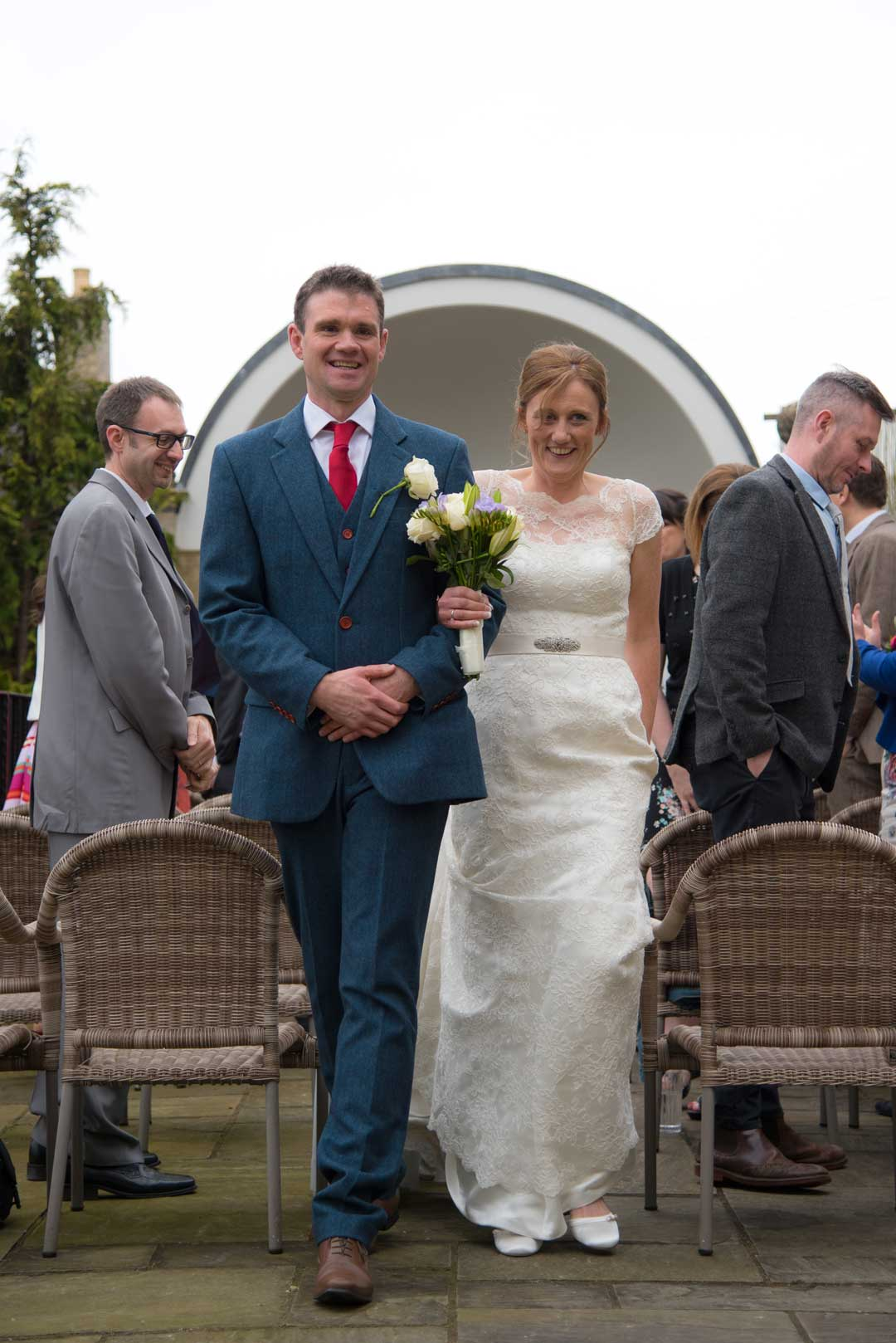 bride and groom down the aisle at outdoor ceremony at the Painswick Hotel