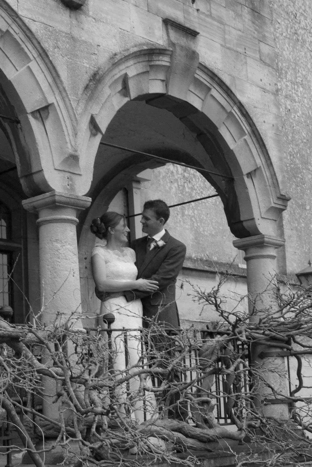wedding couple on the balcony in April at The Painswick Hotel in Gloucester in black and white