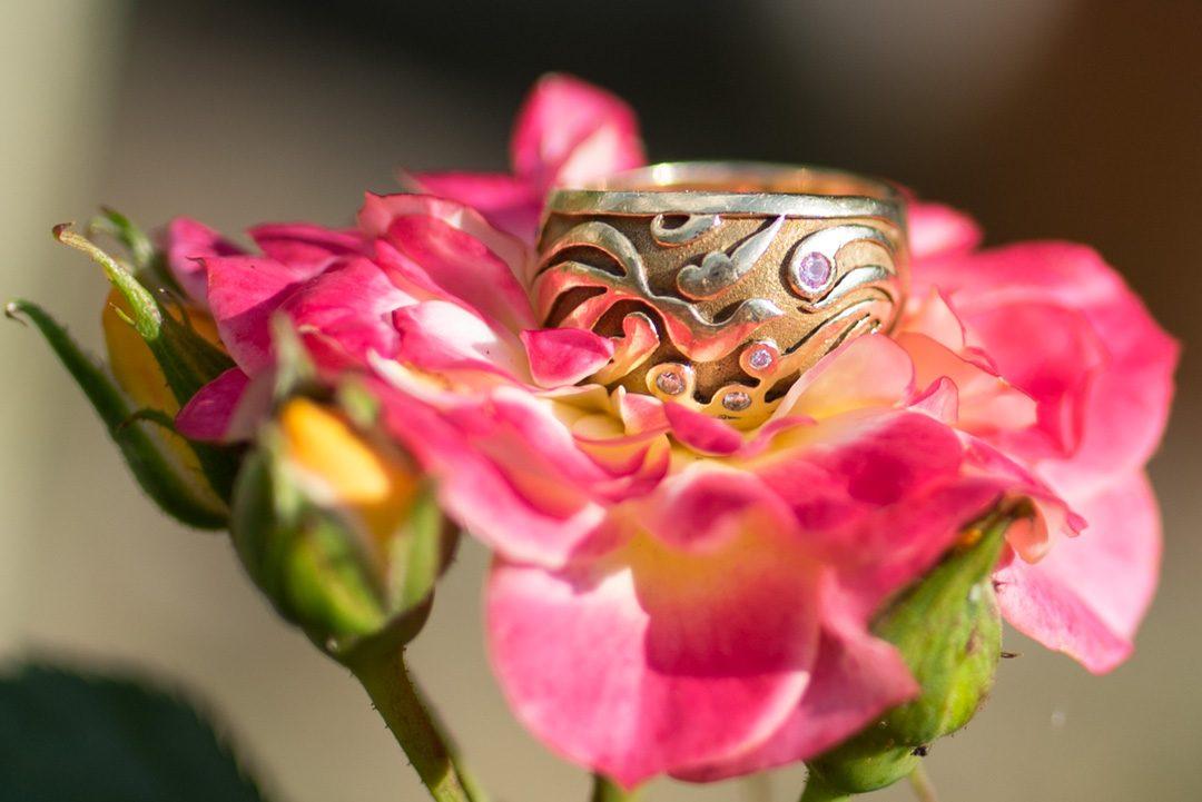 amazing phoenix wedding band with diamond and pink sapphire by Oria