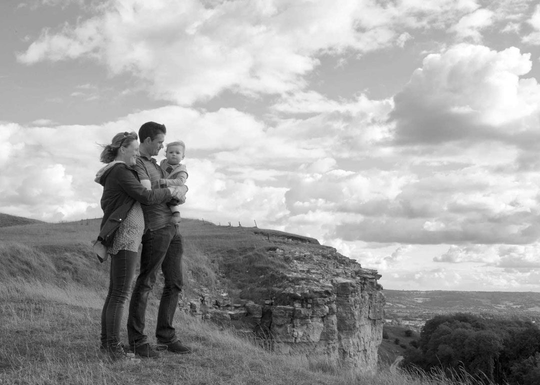 epic engagement shoot with baby at Cleeve Hill Cheltenham in black and white